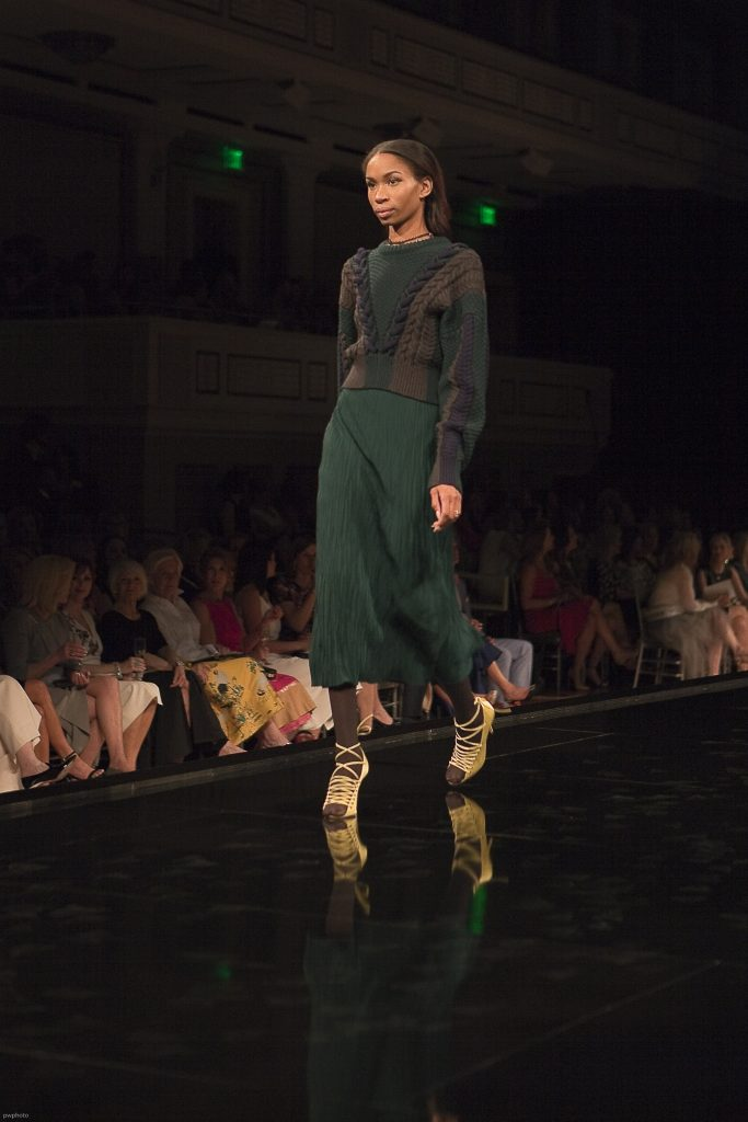 Model wearing Wu Jason Green Skirt and Sweater at Symphony Fashion Show